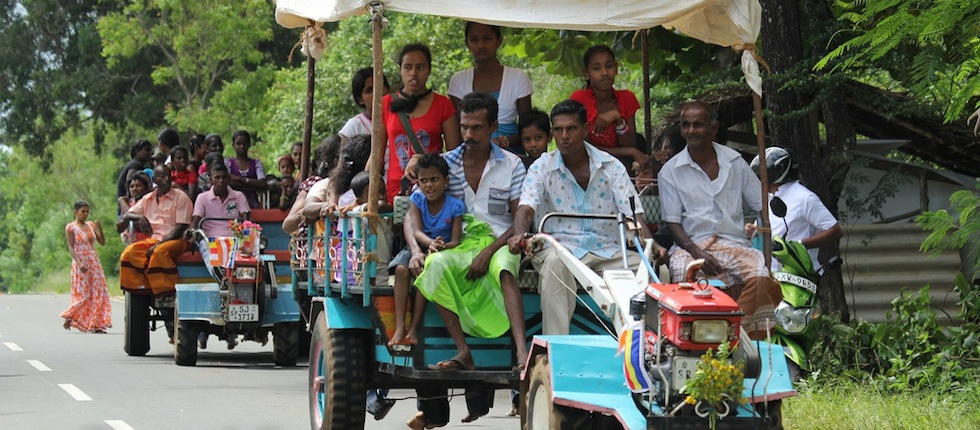 indian families travelling on open tractors, by Insider Tours